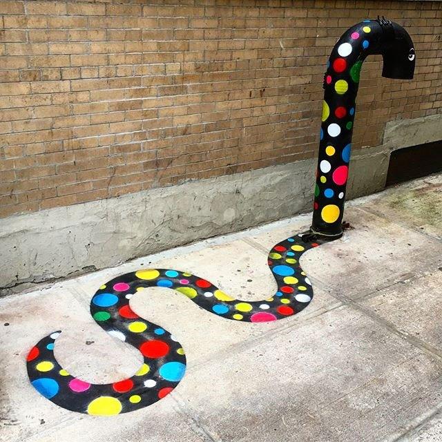 un artiste de rue ajoute de la couleur la ville de new york. Black Bedroom Furniture Sets. Home Design Ideas