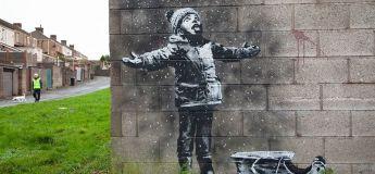 La dernière oeuvre de Banksy de l'année avec ce garçon qui attend la neige…