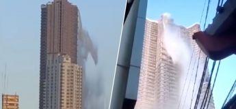 L'eau d'une piscine coulait d'un toit d'un gratte-ciel à cause d'un terrible tremblement de terre qui a frappé les Philippines