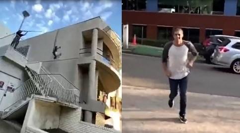 Après un saut spectaculaire du haut d'une maison, il a failli se faire écraser par une voiture après son atterrissage